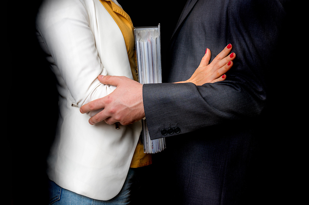 Unwanted touch between man and woman in workplace